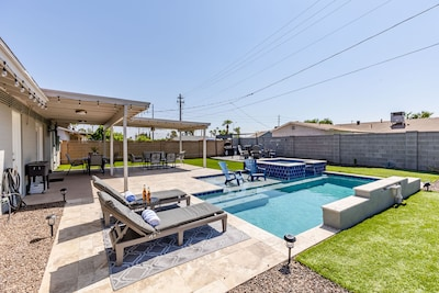 Private backyard with pool, hot tub, multiple seating area and large backyard