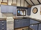 Full kitchen with cookware, dishes, microwave, refrigerator, & more.
