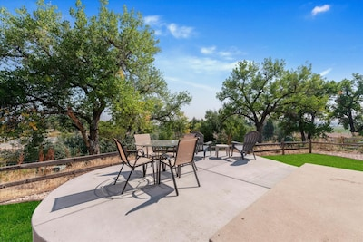 New elevated patio with serene views of Grange Creek green belt.