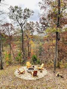 Fire pit where smores and ghost stories are shared