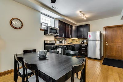 Our open kitchen has a dining table for 6, and new appliances